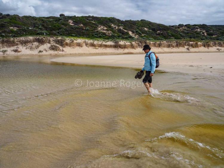 Man walking through Yallingup Brook on Smiths Beach