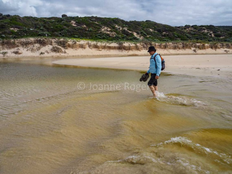 Man walking through Yallingup Brook on Smiths Beach